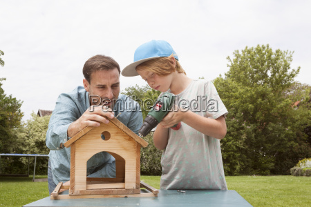 father and son building up a