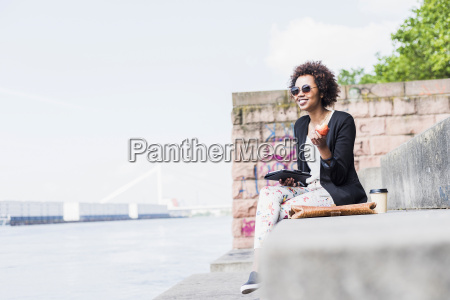 germany mannheim young woman with digital