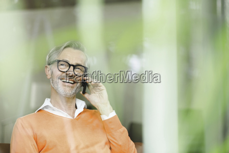 man on the phone looking through