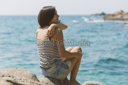 woman with summer clothes looking out