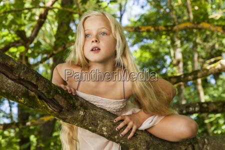 portrait of blond little girl climbing