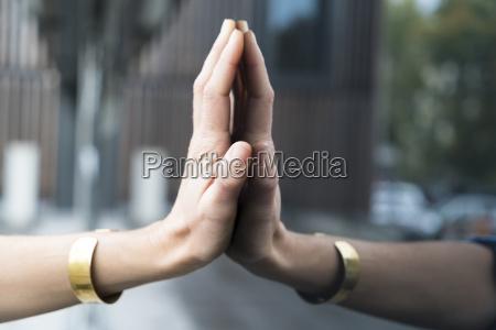 womans hand touching glass pane