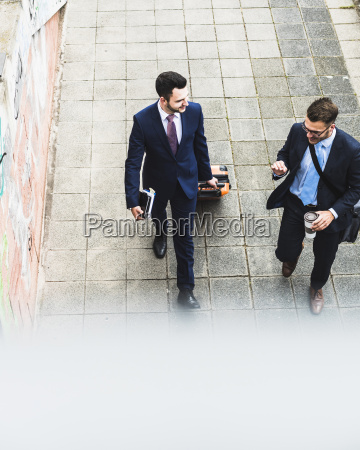 businessmen on business trip walking with