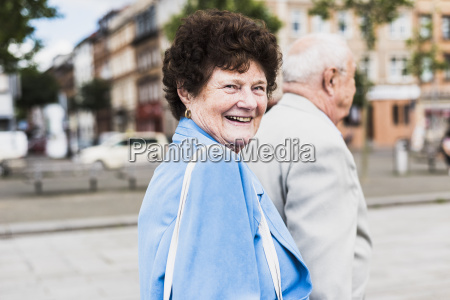 portrait of senior woman strolling with