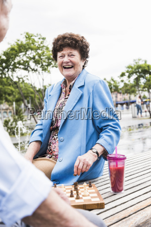 laughing senior woman sitting on a