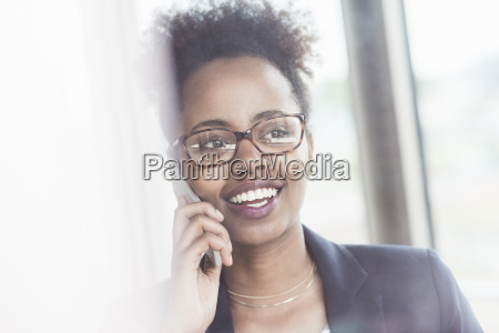 portrait of smiling businesswoman looking through