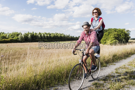 happy young couple on a bicycle