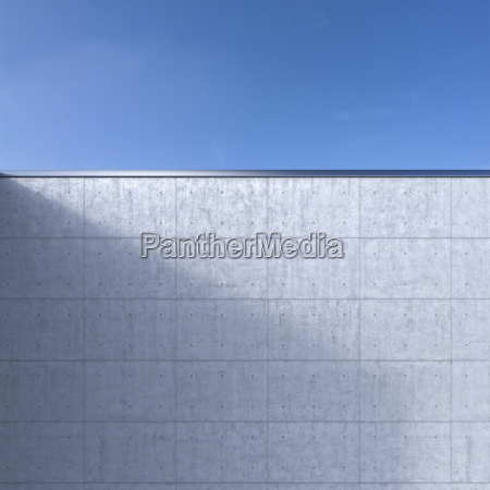 concrete wall in front of blue