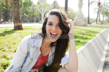 happy young woman in park portrait
