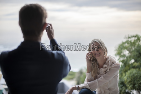 man taking picture and woman on