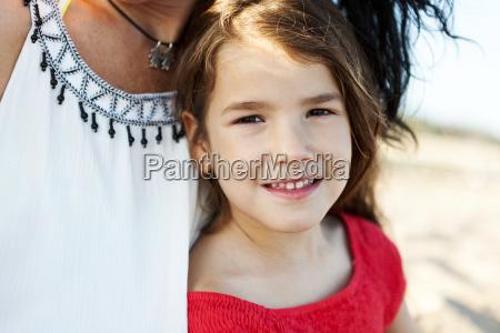 portrait of smiling little girl besides