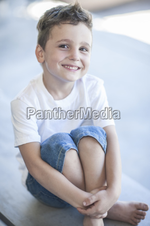 portrait of smiling little boy sitting