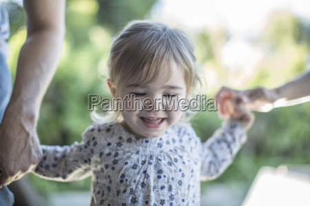 portrait of smiling baby girl holding