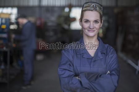 portrait of confident female mechanic in