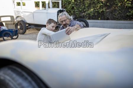 senior man and boy with digital
