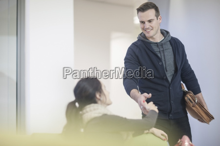young woman and man shaking hands