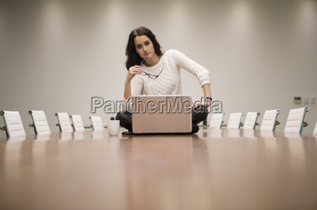 businesswoman with laptop sitting on conference