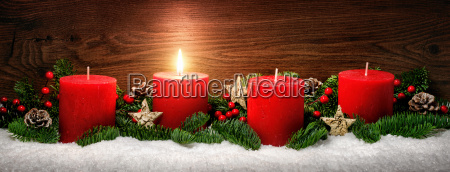 advent decoration with a candle flame