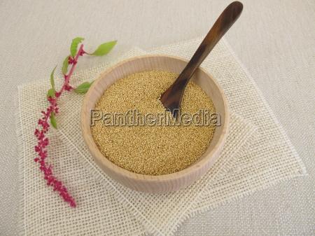 amaranth grains in a wooden bowl