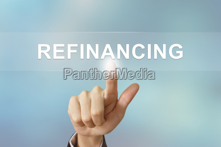 business hand clicking refinancing button on