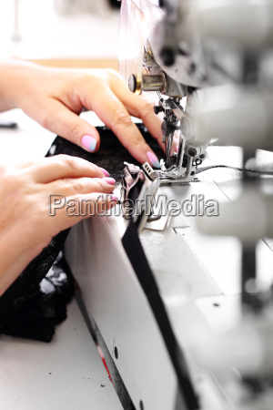 seamstress at the machine clothing production