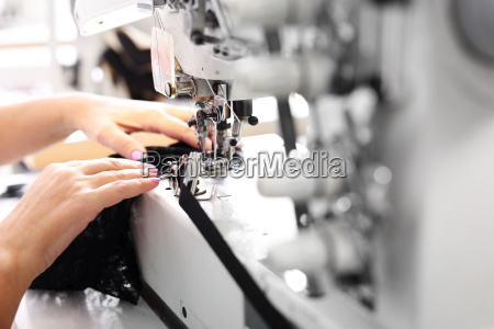 sewing seamstress on the machine production