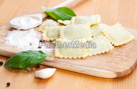 raw ravioli and basil
