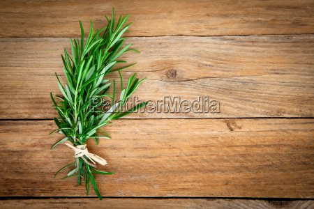 rosemary bound on a wooden background