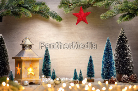 christmas arrangement with lanterntreestree branchesstar and
