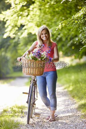 woman on cycle ride in countryside