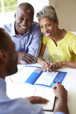mature black couple meeting with financial