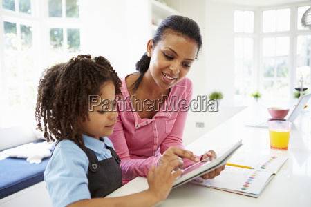 mother and child using digital tablet