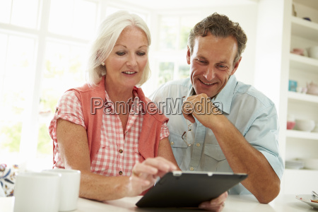 smiling middle aged couple looking at