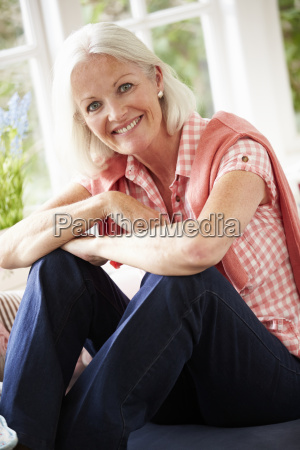 portrait of middle aged woman sitting