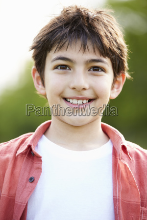portrait of smiling hispanic boy in