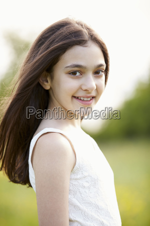 portrait of smiling hispanic girl in