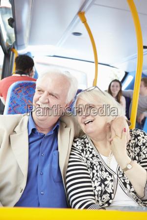 senior couple enjoying journey on bus