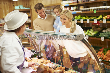female sales assistant serving family in