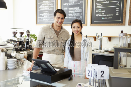 male and female staff in coffee