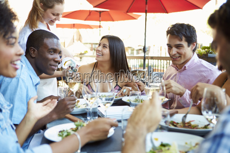 group of friends enjoying meal at