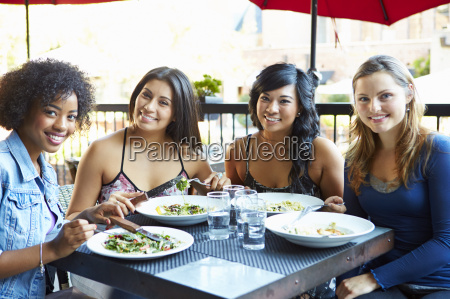 group of female friends enjoying meal