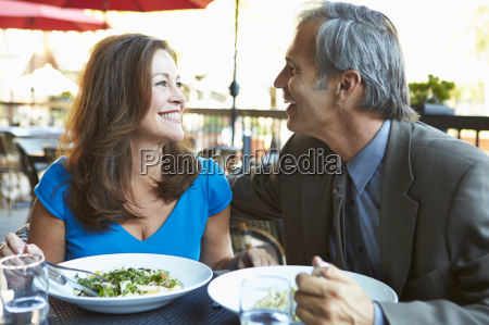 mature couple enjoying meal at outdoor