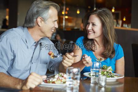 mature couple enjoying meal in restaurant