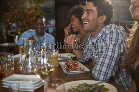group of friends enjoying meal in