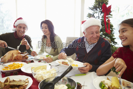 multi generation family enjoying christmas meal