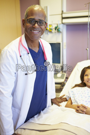 young girl talking to male doctor