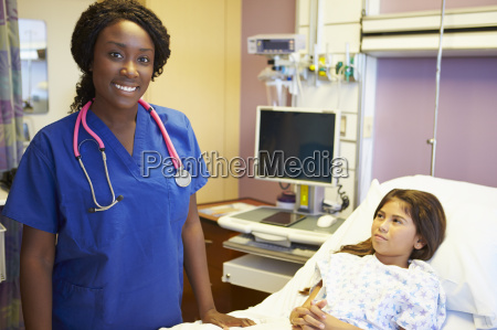 young girl talking to female nurse