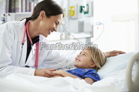 young girl talking to female doctor