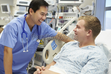 young male patient talking to male
