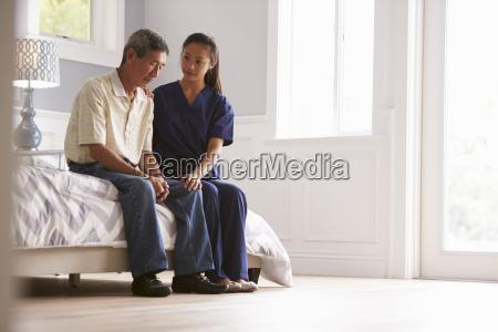 nurse making home visit to depressed